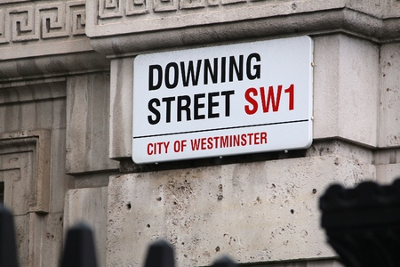 the prime minister: LONDON, UK - APRIL 23, 2016: Downing Street sign in London, UK. 10 Downing Street is the office of British Prime Minister.