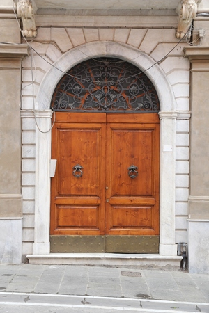 ornate door: Massa - town in Tuscany, Italy. Ornate door architecture. Editorial
