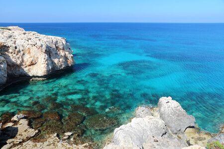 azure: Azure sea landscape at Cape Greco in Cyprus. Stock Photo