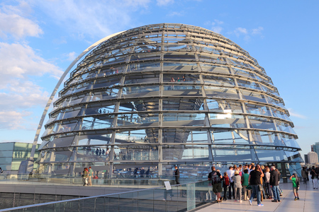 foster: BERLIN, GERMANY - AUGUST 27, 2014: People visit Reichstag building dome in Berlin. The dome was completed in 1999. It was designed by architect Norman Foster.