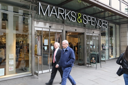 famous industries: LONDON, UK - APRIL 22, 2016: People shop in Marks and Spencer in London, UK. M&S is a major retailer with 1,010 stores in 41 countries. It specializes in fashion and luxury goods. Editorial