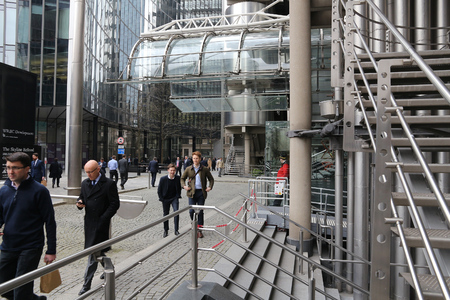 lloyd's of london: LONDON, UK - APRIL 22, 2016: People visit Lloyds Building in the City of London, UK. London is the most populous city and metropolitan area of the European Union with 9,787,426 people in 2011.