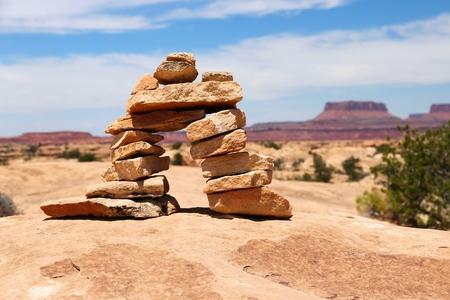 cairns: United States nature in Utah. Needles district of Canyonlands National Park. Hiking trail cairns. Stock Photo