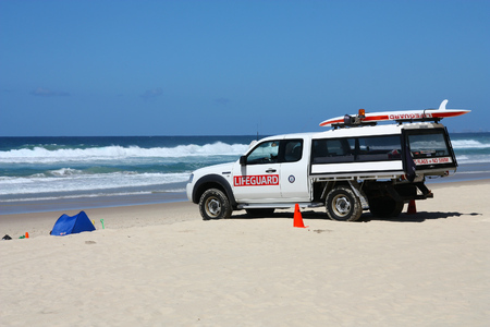 surfers paradise: GOLD COAST, AUSTRALIA - MARCH 25, 2008: Lifeguard vehicle in Surfers Paradise, Gold Coast, Australia. The country has more than 11,500 beaches and employs 700 lifeguards.