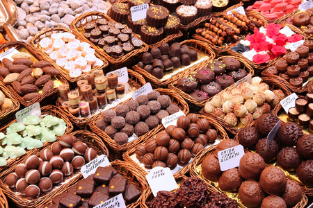 confectionery: Confectionery at Boqueria market place in Barcelona, Spain. Assorted chocolate candy shop. Stock Photo
