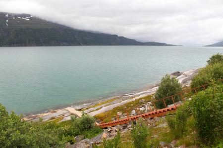fiord: Sjona fiord landscape, Norway. Metal steps down to the sea.