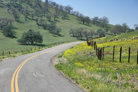 time drive: California, United States - winding road in countryside landscape of Tulare County. Stock Photo
