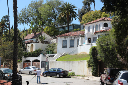 hollywood hills: HOLLYWOOD, UNITED STATES - APRIL 5, 2014: Person walks in Hollywood Hills residential area in Los Angeles, California. Real estate rates in California have grown 105 percent since 1990.