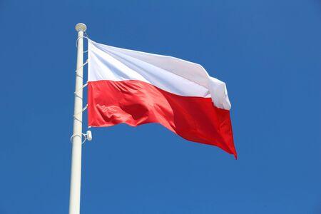 flagpole: Polish flag - national colors of Poland on a flagpole. Stock Photo