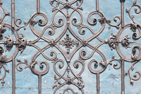 feature: Architecture feature in Wroclaw, Poland - vintage cast iron gate ornaments. Stock Photo