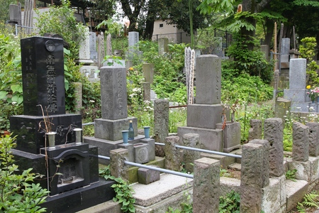 cremated: TOKYO, JAPAN - MAY 9, 2012: Aoyama Cemetery in Tokyo, Japan. As of 2007, 99.8 percent of Japanese deceased were cremated.