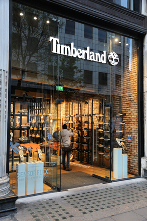 timberland: LONDON, UK - APRIL 23, 2016: People shop at Timberland, Oxford Street in London. Oxford Street has approximately half a million daily visitors and 320 stores.