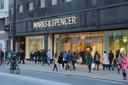 spencer: LONDON, UK - APRIL 23, 2016: People shop at Marks and Spencer, Oxford Street in London. Oxford Street has approximately half a million daily visitors and 320 stores.