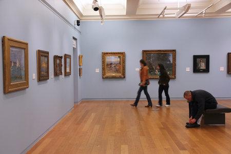 publicly: MANCHESTER, UK - APRIL 22, 2013: People visit Manchester Art Gallery in Manchester, UK. MAG is a publicly owned art gallery. It had 378,650 visitors in 2010.