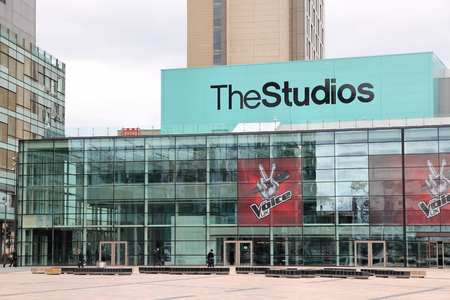 bbc: MANCHESTER, UK - APRIL 22, 2013: People visit Studios MediaCityUK in Manchester, UK. MediaCityUK is a 200-acre development completed in 2011, used by BBC, ITV and other companies. Editorial