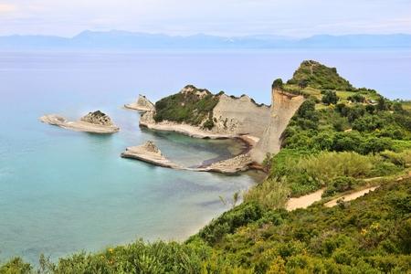 Corfu island landscape - Cape Drastis coast in Greece. Ionian Sea summer view.