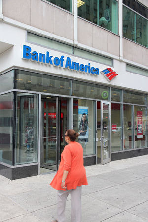 bank of america: PHILADELPHIA, USA - JUNE 11, 2013: Person walks by Bank of America branch in Philadelphia. Bank of America is the 2nd largest bank holding in the USA with assets of 2.1 trillion USD (2013).