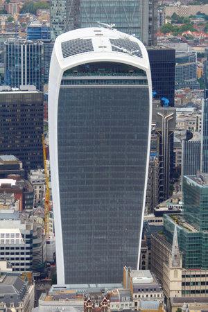 talkie: LONDON, UK - JULY 8, 2016:  20 Fenchurch Street skyscraper in London, UK. The postmodern style office building was designed by Rafael Vinoly. It is nicknamed Walkie Talkie.