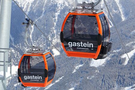 ski runs: BAD GASTEIN, AUSTRIA - MARCH 10, 2016: Gondolas of cable car in Bad Gastein. It is part of Ski Amade, one of largest ski regions in Europe with 760km of ski runs. Editorial