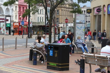 sheffield: SHEFFIELD, UK - JULY 10, 2016: People visit Fargate shopping area in Sheffield, Yorkshire, UK. Sheffield is the 6th largest city in the UK with population of 529,541.