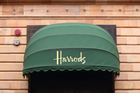 knightsbridge: LONDON, UK - JULY 9, 2016: Harrods department store in London. The famous retail establishment is located on Brompton Road in Knightsbridge district. Editorial