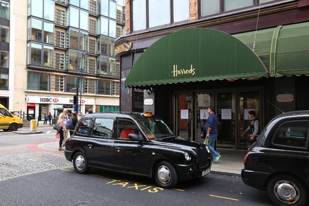 knightsbridge: LONDON, UK - JULY 9, 2016: People visit Harrods department store in London. The famous retail establishment is located on Brompton Road in Knightsbridge district.