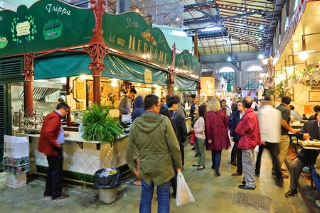 trippa: FLORENCE, ITALY - APRIL 30, 2015: People shop at Mercato Centrale market in Florence, Italy. The market is an ultimate Italian shopping experience. It was opened in 1874.
