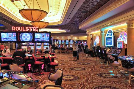 caesars palace: LAS VEGAS, USA - APRIL 14, 2014: People visit Caesars Palace casino resort in Las Vegas. The famous casino resort has almost 4,000 rooms.