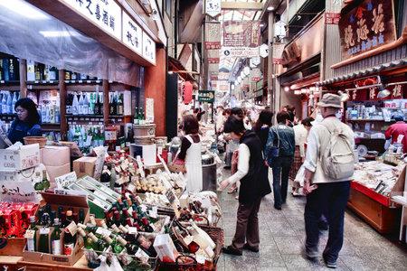 billion: KYOTO, JAPAN - APRIL 19, 2012: People shop at Nishiki market in Kyoto, Japan. Retail market in Japan amounted to 832.6 billion in 2011.