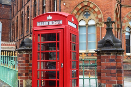 infirmary: Leeds - city in West Yorkshire, UK. Red telephone and Leeds General Infirmary in background. Stock Photo