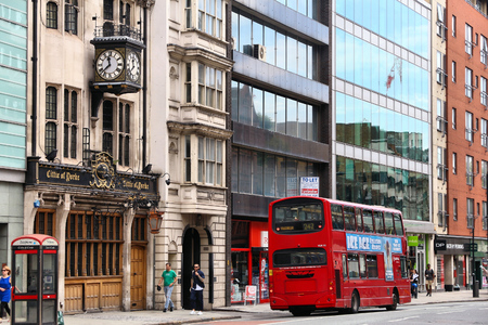yorke: LONDON, UK - JULY 9, 2016: People walk along High Holborn street, London, UK. London is the most populous city in the UK with 13 million people living in its metro area.