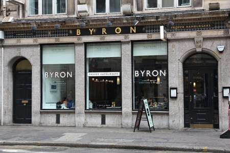 byron: LONDON, UK - JULY 9, 2016: People visit Byron hamburger restaurant in London. According to Tripadvisor there are at least 20,700 restaurants in London.