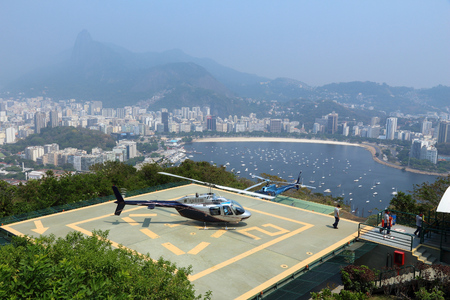 heliport: RIO DE JANEIRO, BRAZIL - OCTOBER 18, 2014: People visit helicopter flightseeing heliport in Rio de Janeiro. In 2013 1.6 million international tourists visited Rio.