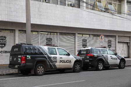 law of brazil: CURITIBA, BRAZIL - OCTOBER 8, 2014: Police cars of Parana region in Curitiba. Brazil has 424,000 police officers.