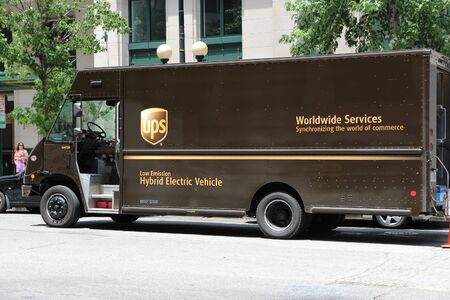 WASHINGTON, USA - JUNE 14, 2013: UPS low emissions hybrid electric delivery truck in Washington DC. UPS is one of largest package delivery companies worldwide with 397,100 employees.