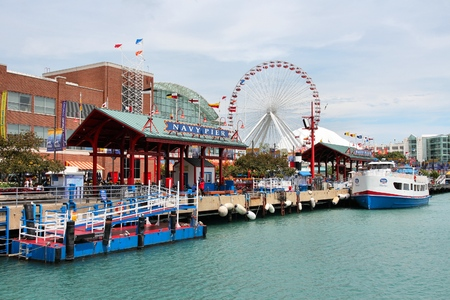 recognized: CHICAGO, USA - JUNE 26, 2013: People visit famous Navy Pier in Chicago. The 3,300-foot pier built in 1916 is one of most recognized Chicago landmarks. Editorial