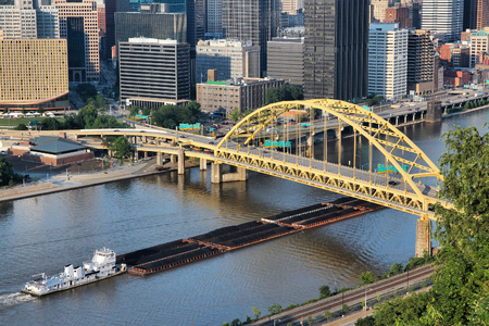 allegheny: Pittsburgh, Pennsylvania - city view with Monongahela River barge transport of coal. Industrial river shipping. Stock Photo