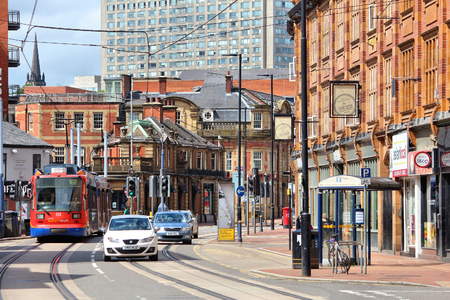 sheffield: SHEFFIELD, UK - JULY 10, 2016: People walk in Sheffield, Yorkshire, UK. Sheffield is the 6th largest city in the UK with population of 529,541. Editorial