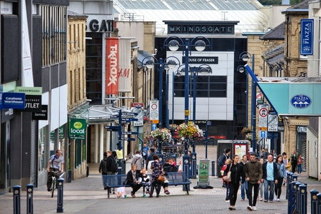 tk: HUDDERSFIELD, UK - JULY 10, 2016: People visit shopping area in Huddersfield, West Yorkshire, UK. Huddersfield is the 11th largest town in the UK with a population of 162,949. Editorial