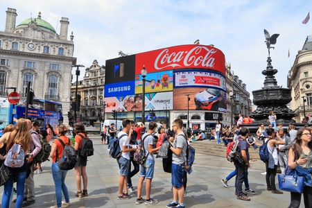 piccadilly: LONDON, UK - JULY 7, 2016: People visit Piccadilly Circus in London. London is the most populous city in the UK with 13 million people living in its metro area. Editorial
