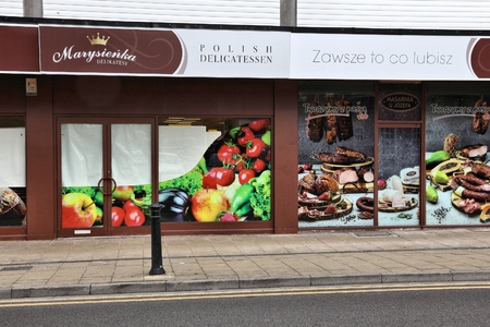 reside: DONCASTER, UK - JULY 12, 2016: Polish delicatessen shop in downtown Doncaster, UK. 790,000 people born in Poland reside in the UK.