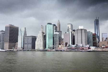 rain cloud: New York City - Manhattan skyline from Brooklyn. Rain cloud sky. Stock Photo