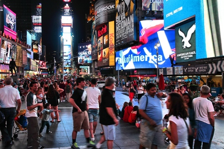 new york times: NEW YORK - JULY 1, 2013: People visit Times Square in New York. Times Square is one of most recognized landmarks in the world. More than 300,000 people pass through Times Square daily. Editorial