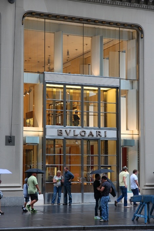 5th: NEW YORK, USA - JULY 1, 2013: People walk by Bulgari fashion shop at 5th Avenue, New York. 5th Avenue is ranked the most expensive retail area (per square foot) in the world. Editorial