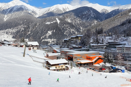ski runs: BAD GASTEIN, AUSTRIA - MARCH 9, 2016: People ski in Bad Gastein. It is part of Ski Amade, one of largest ski regions in Europe with 760km of ski runs.