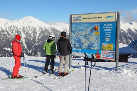 ski runs: BAD HOFGASTEIN, AUSTRIA - MARCH 9, 2016: People analize map in Bad Hofgastein. It is part of Ski Amade, one of largest ski regions in Europe with 760km of ski runs. Editorial