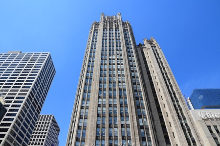 historic district: CHICAGO, USA - JUNE 27, 2013: Tribune Tower neo-gothic skyscraper in Chicago. It is 462 ft (141 m) tall and is part of Michigan-Wacker Historic District. Editorial