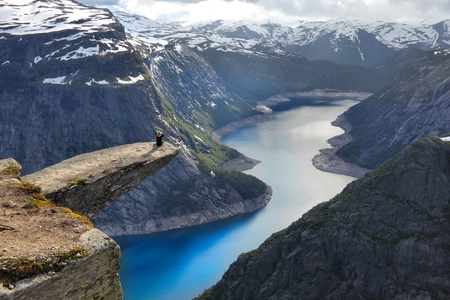 Norway tourism attraction - Trolltunga (Trolls Tongue) rock in Hordaland county. Ringedalsvatnet lake.