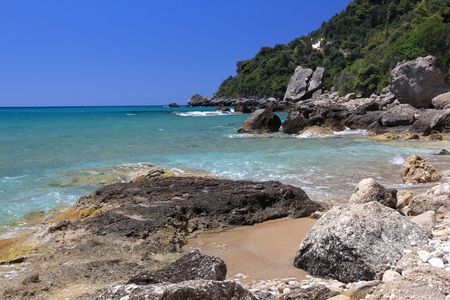 Corfu beach landscape - island in Greece. Myrtiotissa Beach below the cliffs.