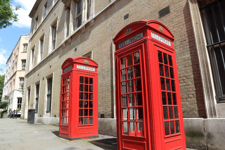 London phone boxes - red telephone booths in the UK. Covent Garden area.
